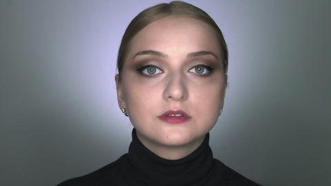 Natural Beauty. Beautiful woman with makeup looks at the camera Live Action