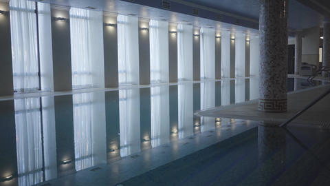 Wide shot of luxurious swimming pool in spa hotel. Concept of luxury tourism Live Action