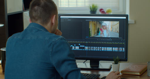 post production and vlog concept - man working in video editor program on laptop Live Action
