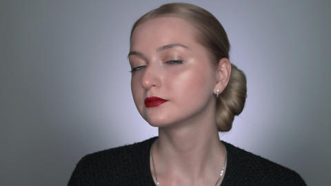 Natural Beauty. Beautiful woman with makeup looks at the camera and posing Live Action