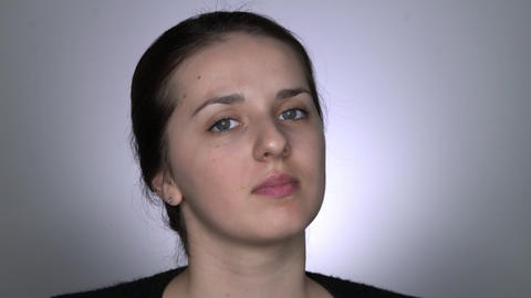 Natural Beauty. Beautiful woman without makeup looks at the camera Live Action