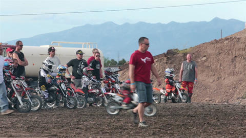 Boys start motorcycle race with parents help HD 8261 Footage