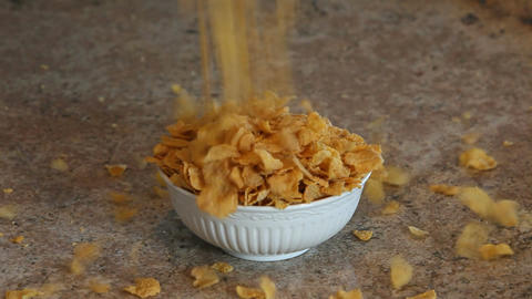 Cereal flakes overflow bowl slow P HD 6253 Footage