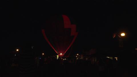 Dark night burn hot air balloon town center 4K 194 Live Action