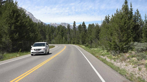 Driving Grand Teton NP forest to mountain POV fast motion 4K Archivo