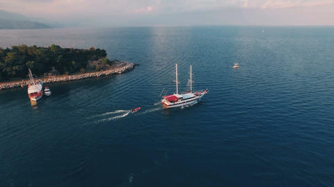 Aerial View of Ship Which Tows a Boat in Sea Bay Footage