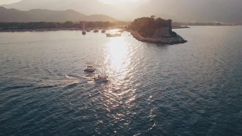Aerial View of Swimming Boat in Sea Bay on Sunset Footage