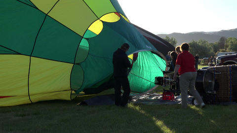 Family filling hot air balloon ready for takeoff 4K 031 Footage