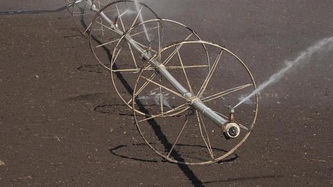 Farm irrigation sprinkler wheel line field fast motion 4K 009 Footage