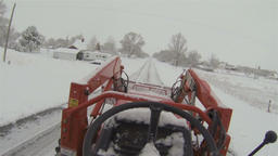 Farm tractor on snow blizzard rural road Point Of View HD 010 Footage