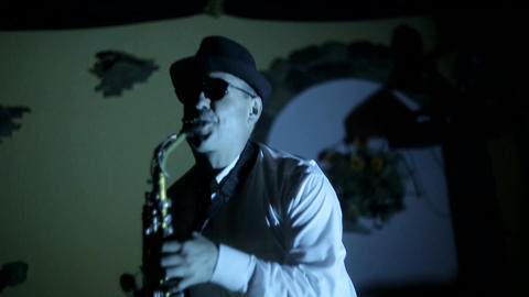 jazz musician playing the saxophone , playing the saxophone , music backlit silhouette Live Action
