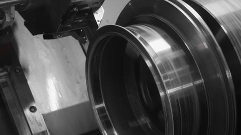Using lathe equipment in the heavy industrial manufacturing factory Live Action