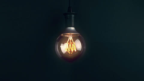 turn on and turn off, with blinking effect, retro vintage light bulb with led technology built-in on Live Action