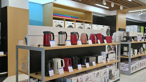 Shelves full of goods in domestic appliance store, mostly of Bosch brand Live Action