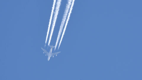Contrails of a Four Engines Jet Airliner Live Action