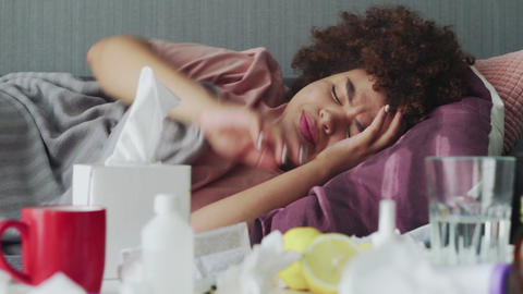 Ill young african american girl is sleeping relaxing during disease lying on Live Action