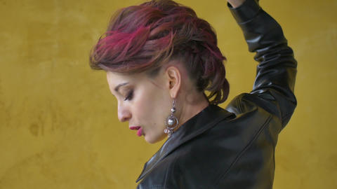 Glamorous lady in punk rock style party clothes with dark pink hair in casual Live Action