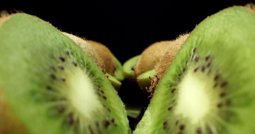 Juicy fresh kiwi fruit HQ cut in half super macro close up shoot fly over 4k shoot on dark Live Action