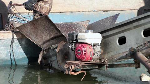 Fisheman loading carp fish into boat conveyor HD 0798 Footage