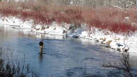 Fisherman in mountain river winter recreation HD 0230 Footage