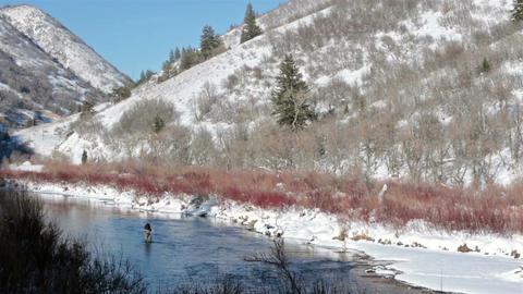 Fishing in high mountain river winter season snow ice HD 0231 Footage