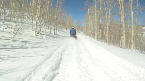 Following snowmobiles on mountain P HD 06 Footage