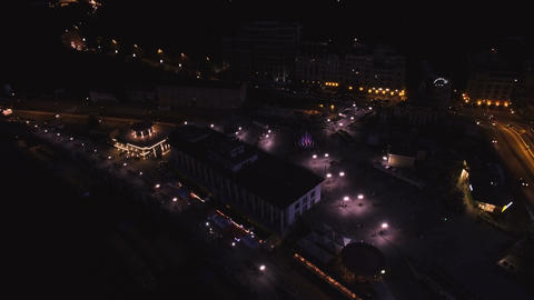 Aerial View of European City at Night with Cars Footage