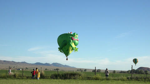 Frog Prince hot air balloon flight across rural farms 4K 045 Footage