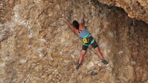 Girl rock climbs Maple Box Canyon safety rope HD 2673 Footage