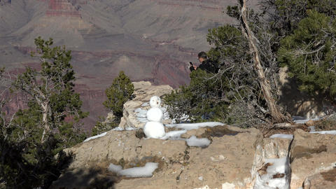 Grand Canyon winter snowman at lookout 4K Footage