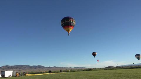 Hot Air Balloons over rural farm land 4K 036 Footage