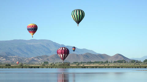 Hot air balloon flight over mountain valley lake 4K 057 Footage