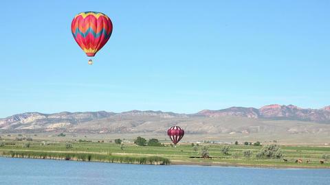 Hot air balloons lake rural farms 4K 062 Footage