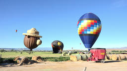 Hot air balloons in rural farm landing field 4K 068 Footage