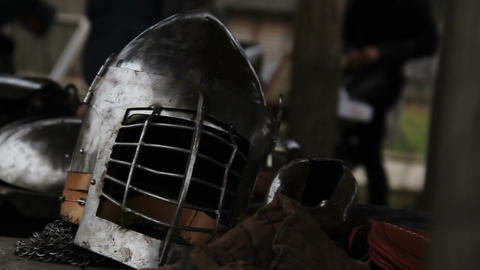 Medieval warriors putting on battle equipment, preparing for military campaign Footage
