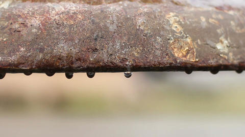 Water leaking from old pipe, rust corroding metal surface, ancient utilities Live Action