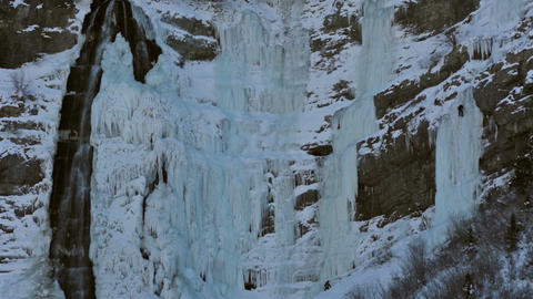 Ice climbers on sheer frozen mountain waterfall HD 0207 Footage