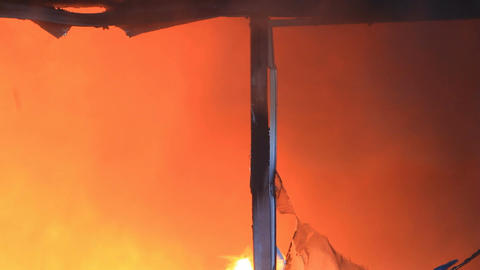 Intense house fire through window P HD 7909 Footage