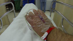 Intravenous therapy male hand in hospital bed room HD 016 Footage