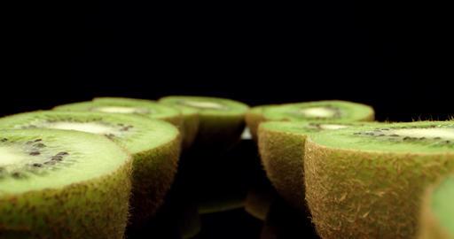 Juicy fresh kiwi fruit Hcut in half super macro close up shoot fly over 4k shoot on dark background Live Action