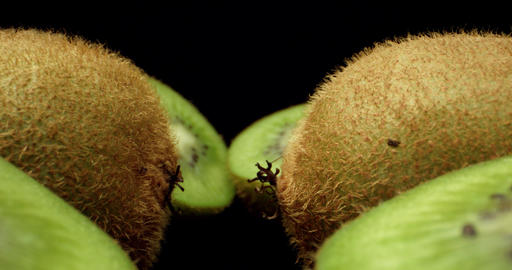 Juicy fresh kiwi fruit cut in half super macro close up high quality shoot fly over shoot on dark Live Action