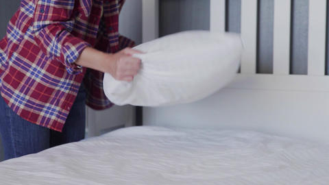 Woman cleaning her bed in bedroom, Beautiful female set up and making bed Live Action