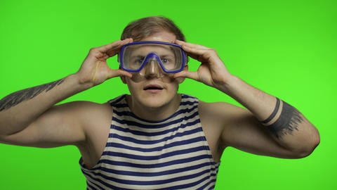 Emotional man tourist in underwater mask, striped sailor shirt on chroma key Live Action