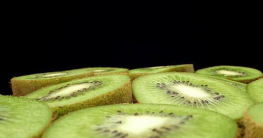Juicy fresh kiwi fruit cut in half super macro close up shoot fly over shoot on dark background HQ Live Action