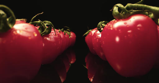 Juicy red cocktail tomatoes super macro close-up 4k with dark background unique high resolution 4k Live Action