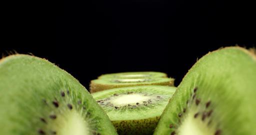 Juicy fresh kiwi fruit cut in half super macro close up shoot fly over shoot on dark background 4k Live Action