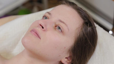 Beautiful woman lies on a couch in a beauty parlor Live Action