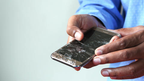 hand holding broken smart phone with empty screen Live Action