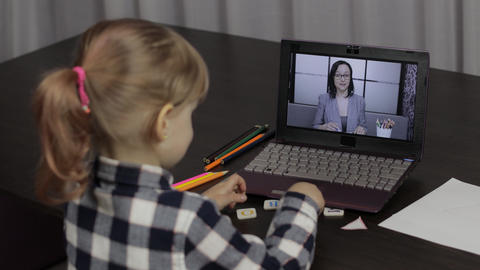 Children distance education on laptop. Online lesson at home with woman teacher Live Action