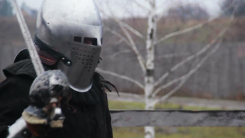 Actors in medieval warriors' suits training before historical fight reenactment Footage